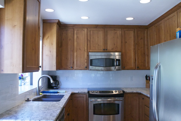 Kitchen with granite, stainless steel appliances and tile