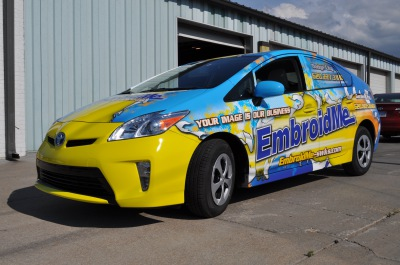 Embroidery business car wrap advertising