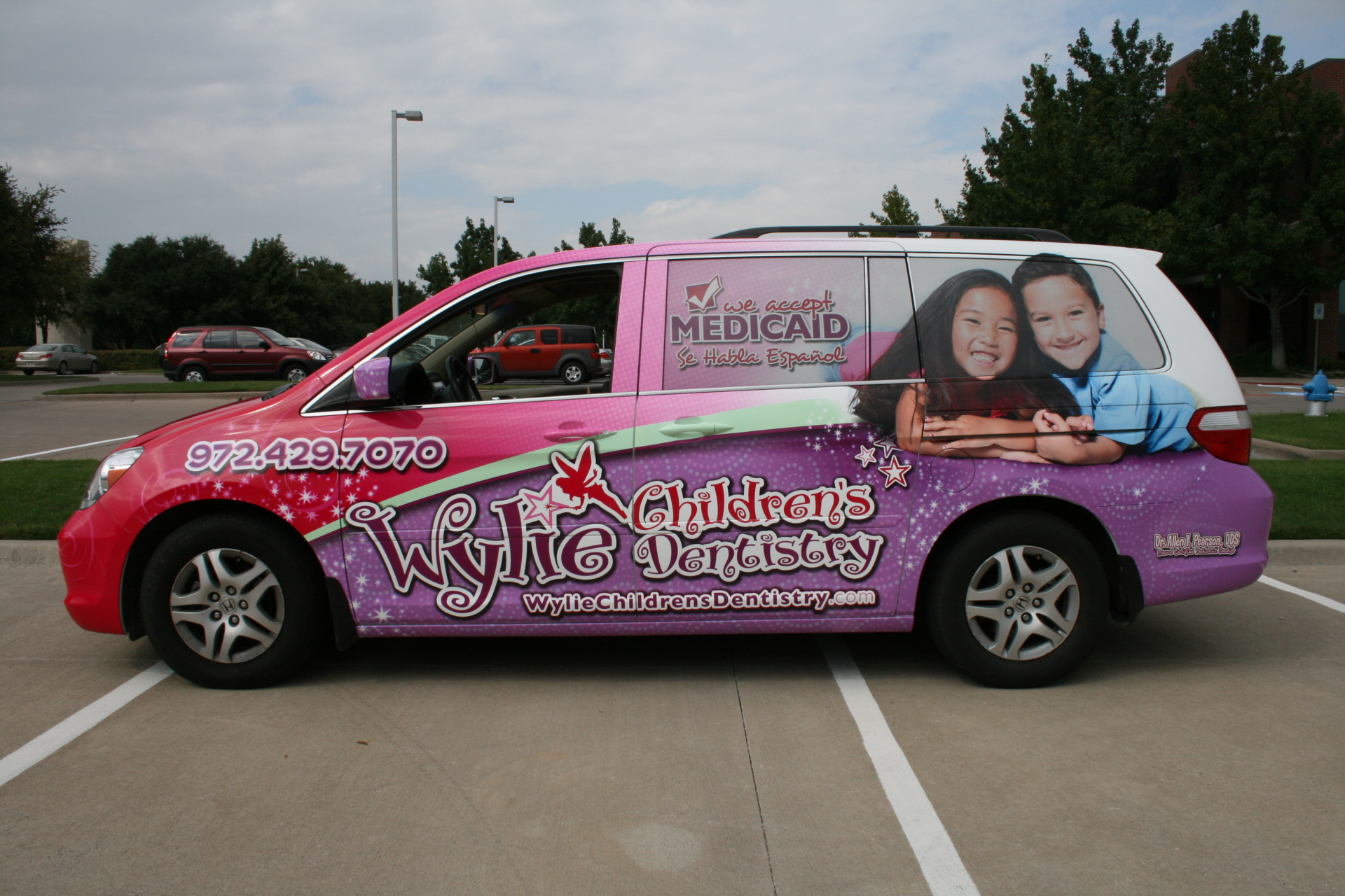 Purple and pink mini van wrap