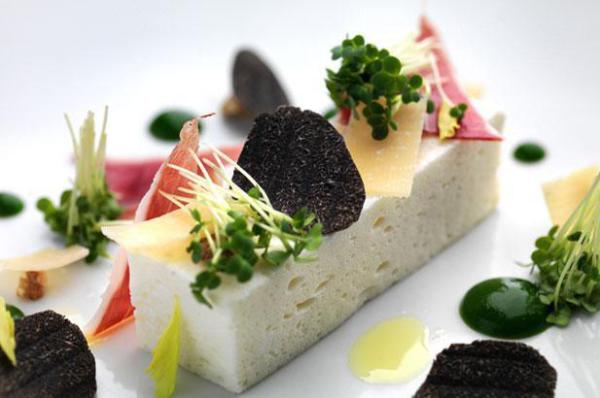 White asparagus pate, black truffle, parmesan shavings, iberian ham, pepper cress and herb oil