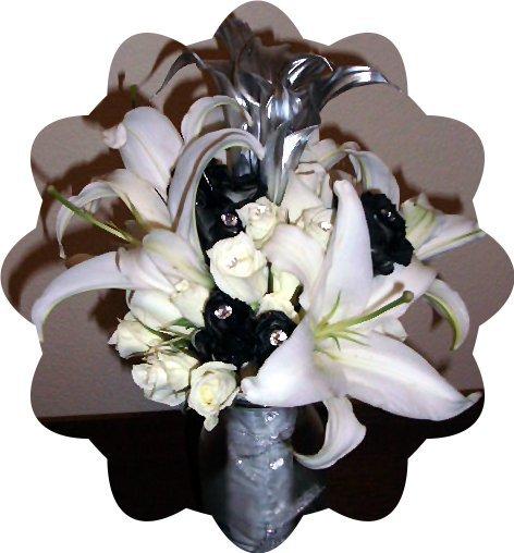 White oriental lilies, black spray roses, and silver mini calla lilies.