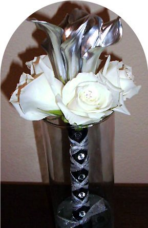 Silver mini calla lilies and white roses.