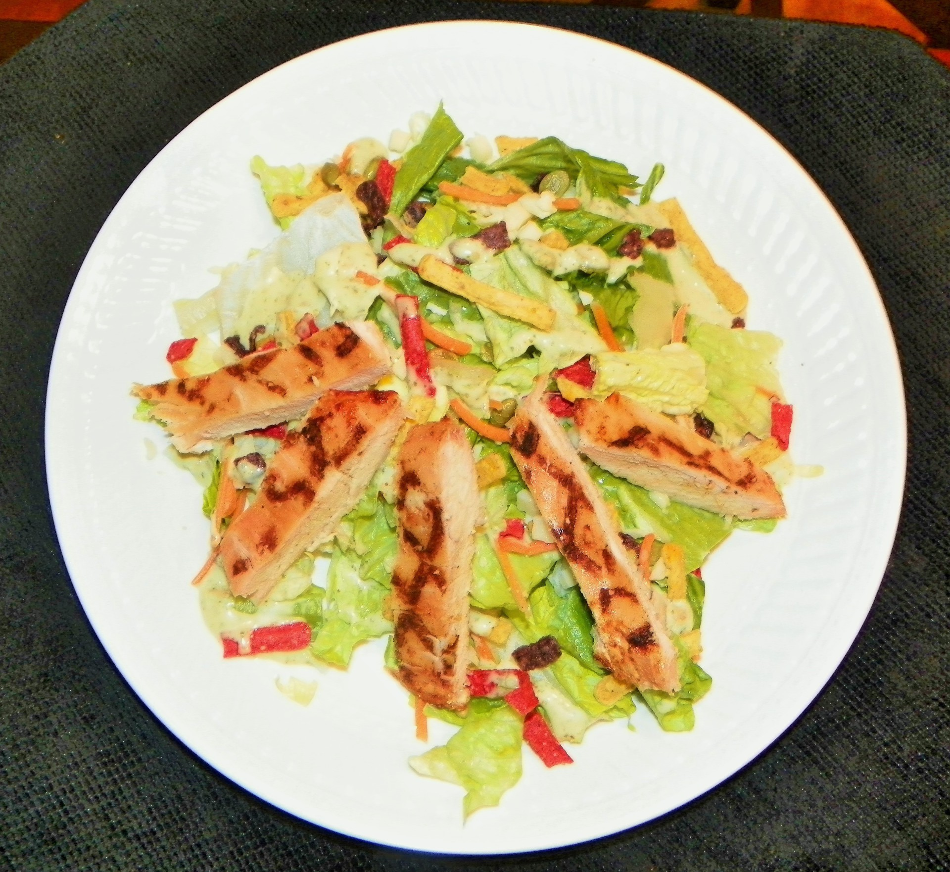 Healthy Eating! Grilled chicken breast salad  topped with a cilantro lime dressing!