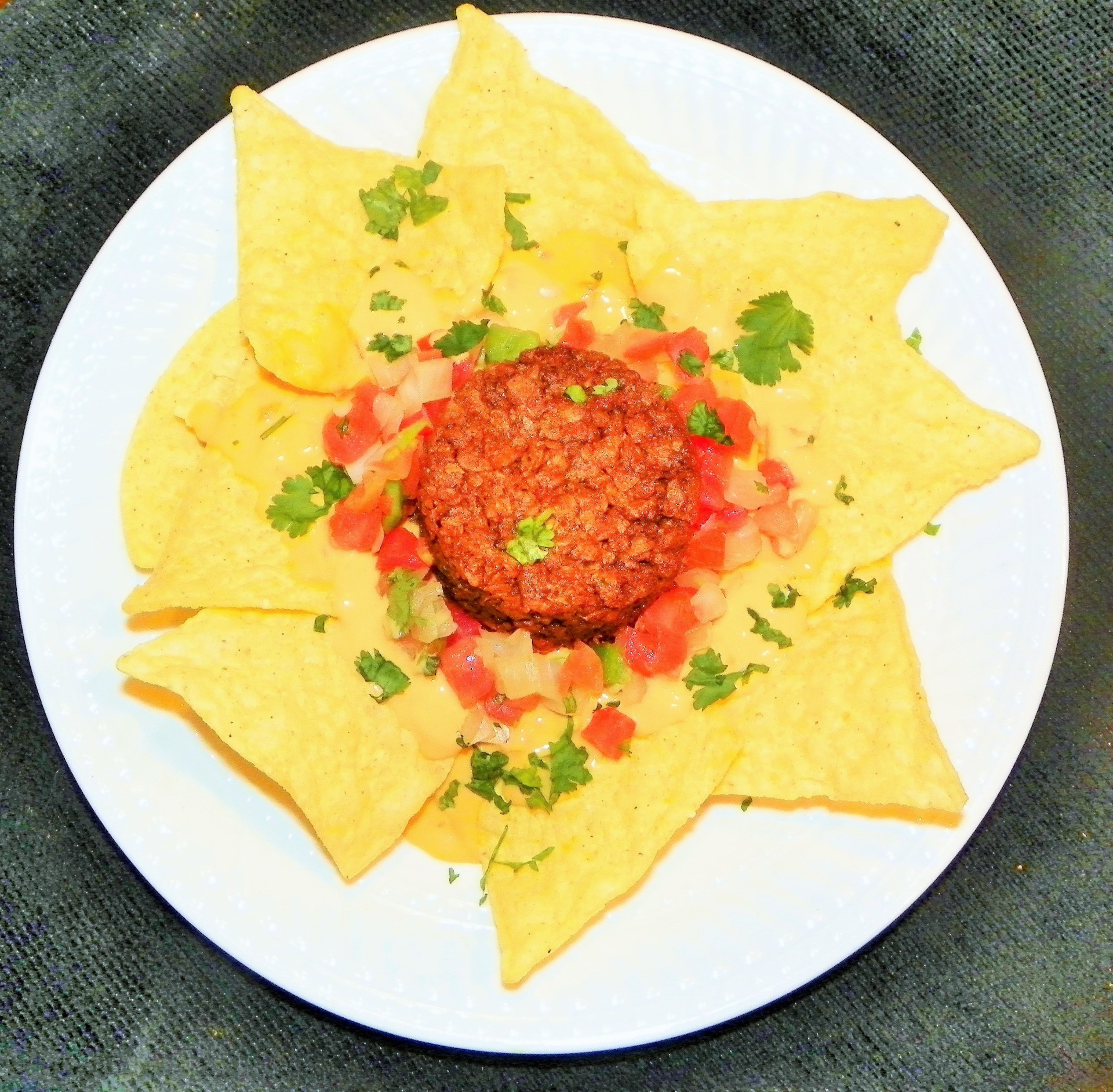 Soy Chorizo for a healthier alternative, with homemade cheese sauce, garnished with fresh Pico de Ga