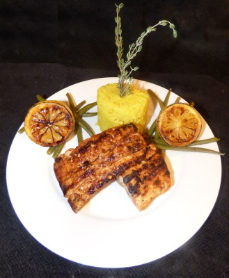 Grilled Mahi Mahi brushed with a sweet Maple Tapatio glaze, saffron rice topped with fresh thyme, paired with steamed green beans, and seared lemons!