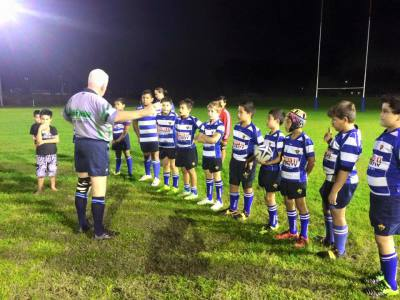 The ref explaining the rules to the under 10 boys before game time