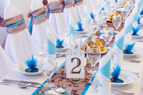 Fun and relaxed blue and burlap wedding/event table