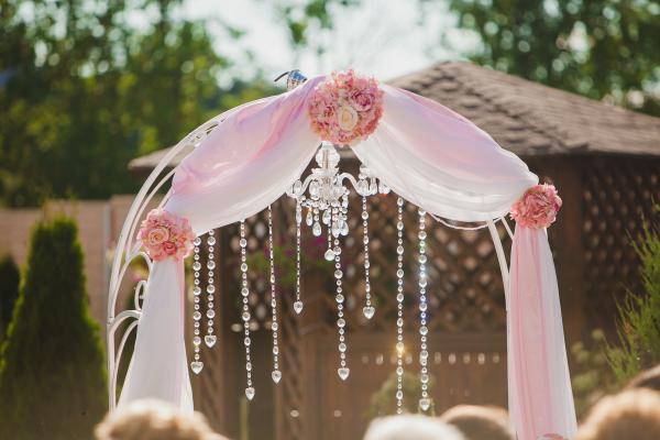 Whimsical wedding arch, pink wedding arch, wedding arbor