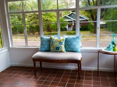 bench in front of window