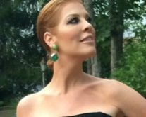 anne tuckley in a black strapless dress