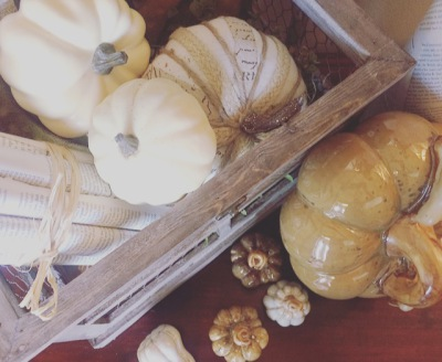 decorative pumpkins in a crate