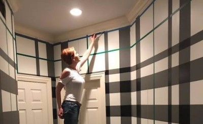 Anne taping the wall