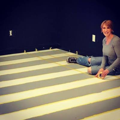 Anne taping floor to paint
