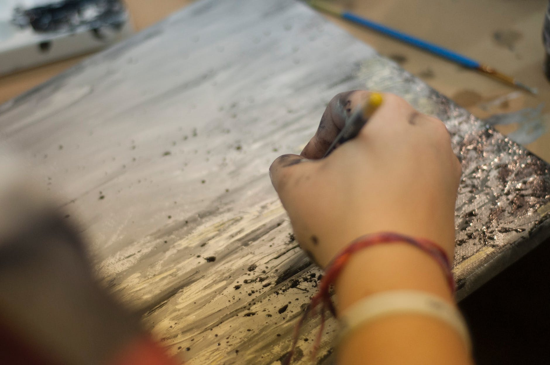woman painting a canvas