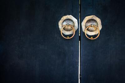 black door with gold knobs