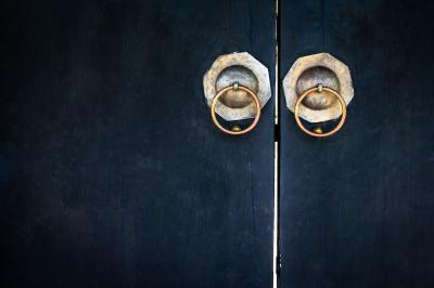 black door with gold knobs