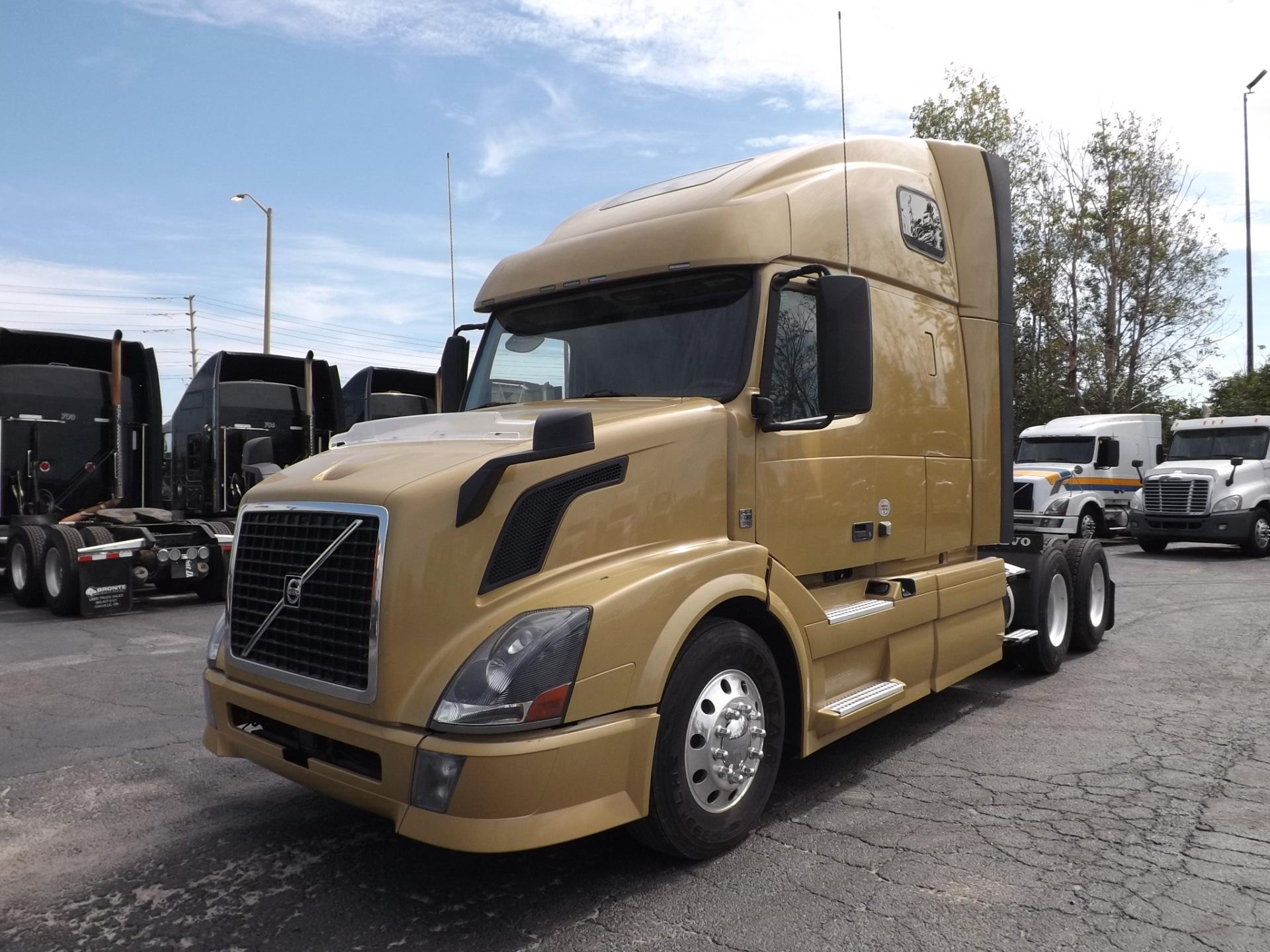 Set of 4 2013 Gold Volvo 670 Highway Tractors
