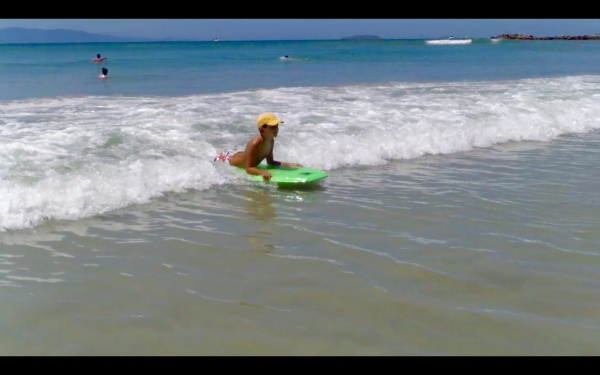 Boogie boarding in front of your condo