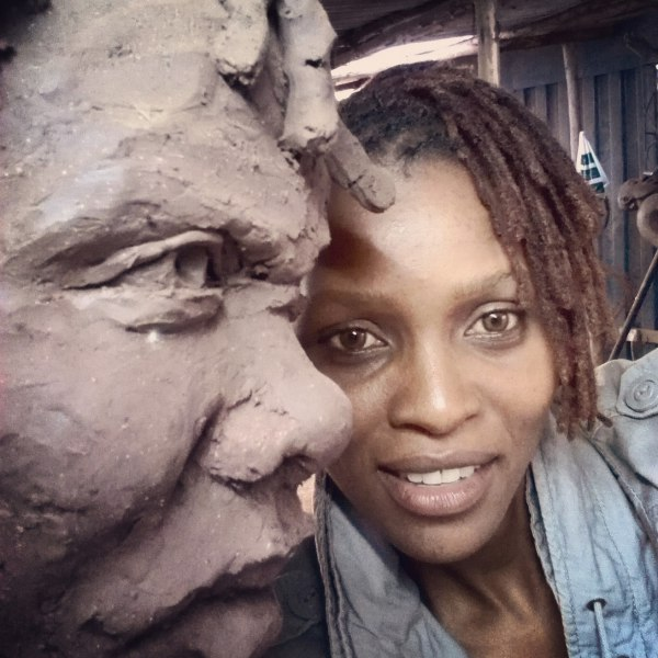 With Dedan Kimathi Sculpture