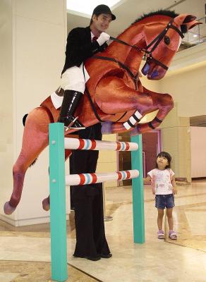 HORSE JUMPING ON STILTS