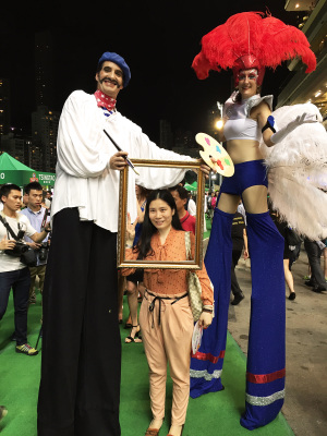 FRENCH PAINTER & FRENCH FEATHER ON STILTS