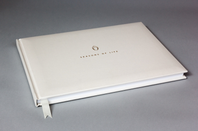 Bespoke, high quality life album, pearl buckram cover, gold foil blocked