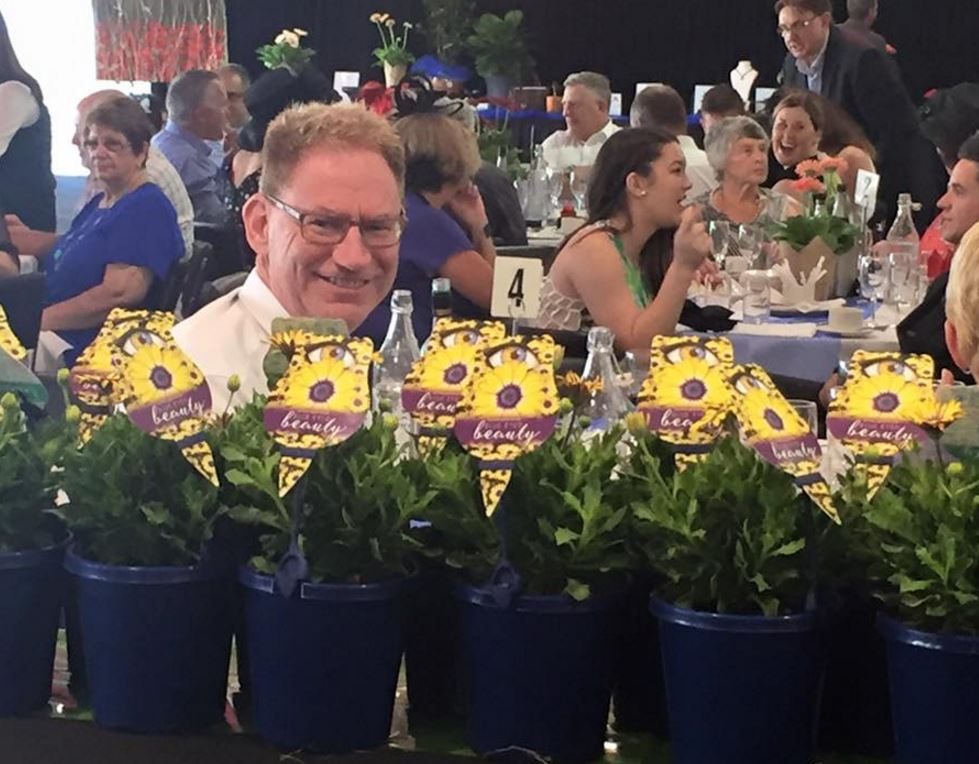 David Eaton from Ball Industries hiding amongst the flower at Adelaide Cup Lunch