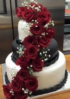 black -white fondant wedding cake with red roses