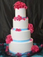 four-tier pink blue wedding cake