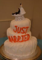 topsy-turvy just married wedding cake