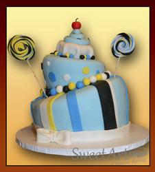 topsy turvy birthday cake with lolly pops
