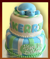 light blue and green baby turtle cake