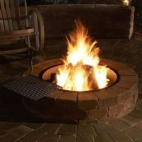 Outdoor firepit with a cooking grate, using the crossfire brass burner by warming trends