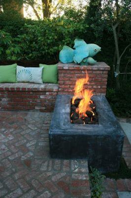 Landscaping stone fire wall using the crossfire brass burner by warming trends