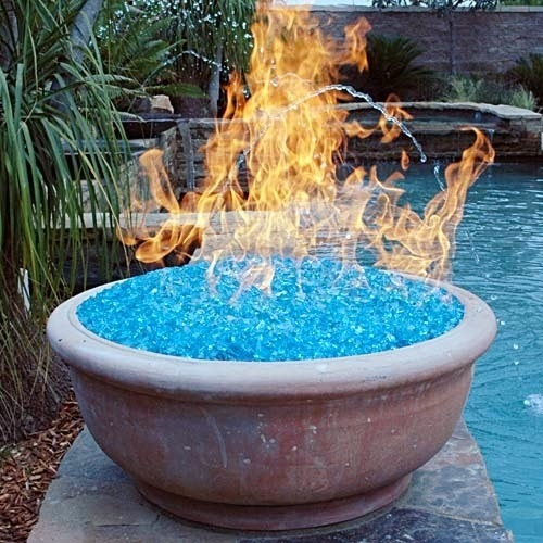 Fire Bowl at poolside, with aqua glass media & using the crossfire brass burner by warming trends