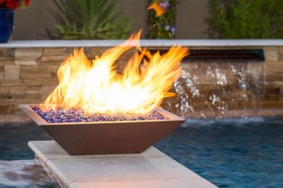 Fire Bowl at poolside, using the cross fire brass burner by warming trends