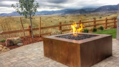 Massive outdoor firepit with volcanic rock, using the crossfire brass burner by warming trends