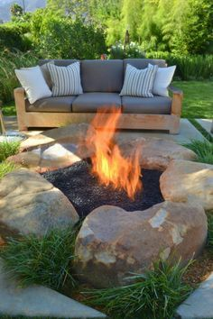 Landscaping rocks with a custom cut crossfire brass burner by warming trends