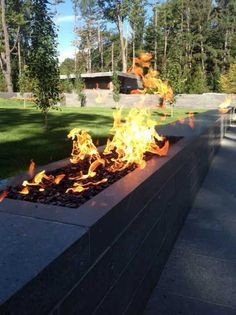 Landscaping stone fire walls, using the crossfire brass burner by warming trends