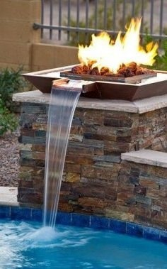 gas outdoor fire bowl by Warming Trends, landscaped to a fountain emptying into a pool