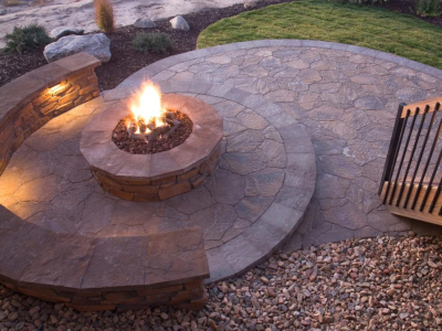 Landscapers design with a firepit/table, using the crossfire brass burner by warming trends