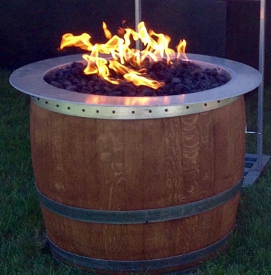 RCF Stoves & Fireplaces uses the crossfire burner by warming trends to make Fire Wine Barrels