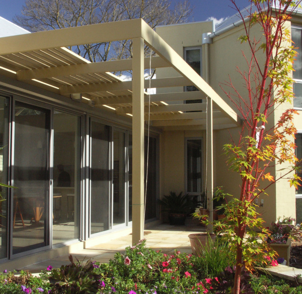 Blackburn House designed by sustainable architect Green Point Design. Passive solar home with studio library.