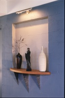 Cornish Hill House designed by sustainable architect Green Point Design. Display niche in thermal wall.