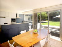 Point Lonsdale House designed by sustainable architect Green Point Design. Sun filled north facing kitchen/meals.