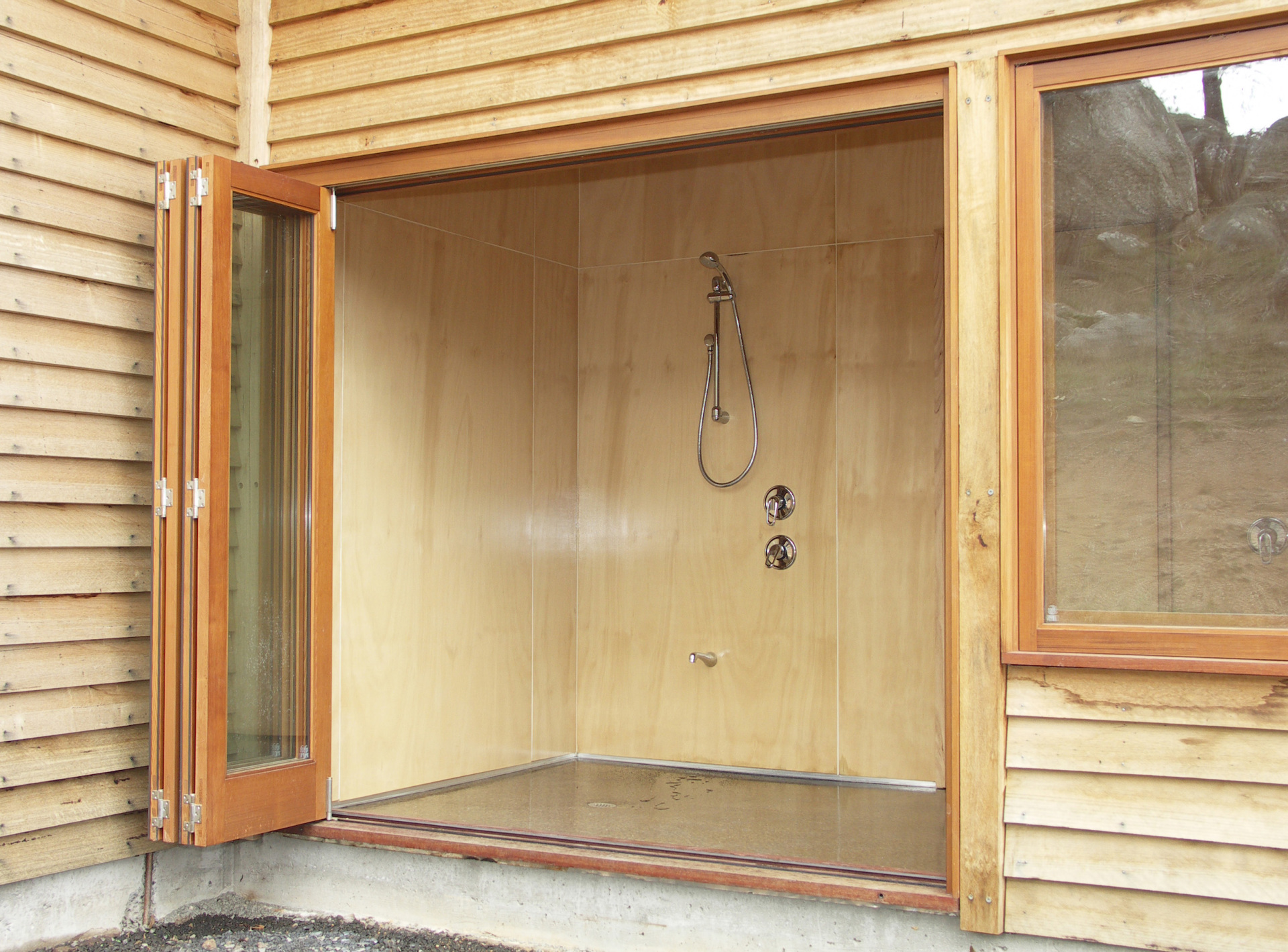 Kyneton House designed by sustainable architect Green Point Design. Stone and timber modern country home. Indoor outdoor shower.