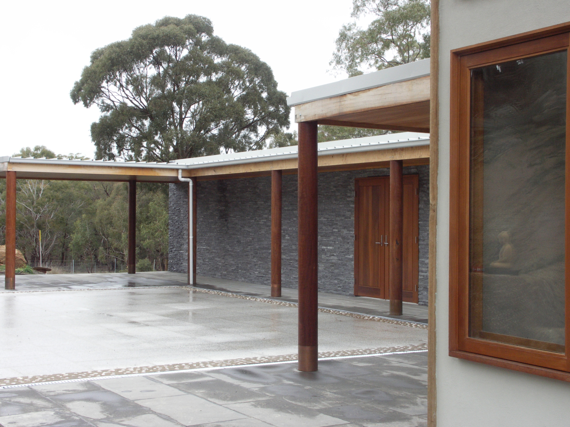 Kyneton House designed by sustainable architect Green Point Design. Sheltered courtyard.