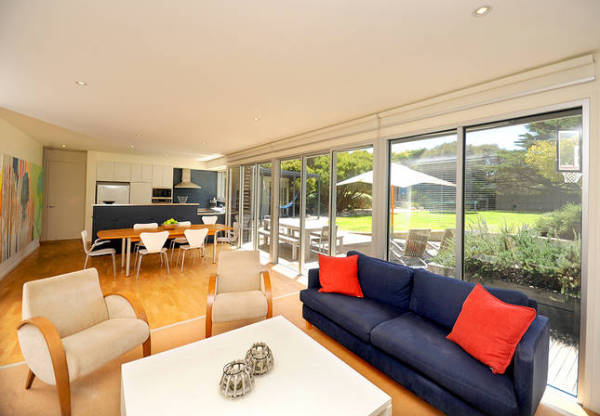 Point Lonsdale House designed by sustainable architect Green Point Design. Sun filled family kitchen living room of beach house.