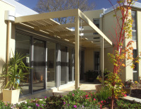 Blackburn House designed by sustainable architect Green Point Design. North facing facade.