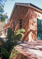 Castlemaine Outbuildings designed by sustainable architect Green Point Design. External view of stables.